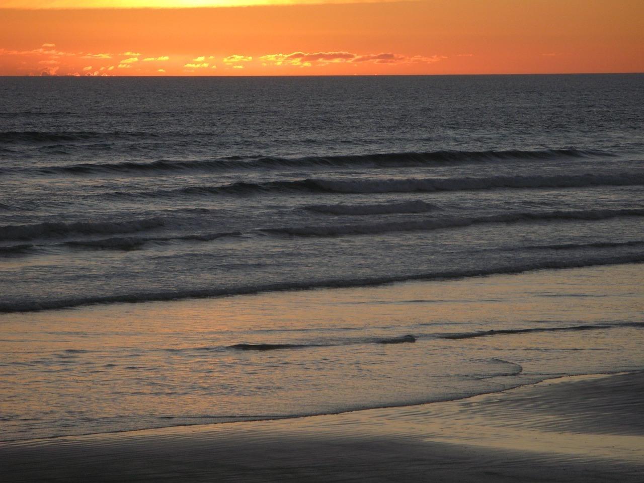 Sunset at Ninety Mile Beach - North Island New Zealand