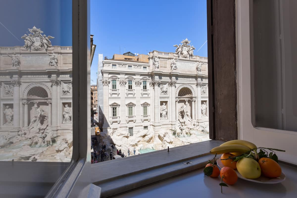 Rome Airbnb With Trevi Fountain View