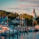 The Marina at Mackinac Island with Saint Anne's church and the historic Victorian houses a sunset shot from Lake Michigan