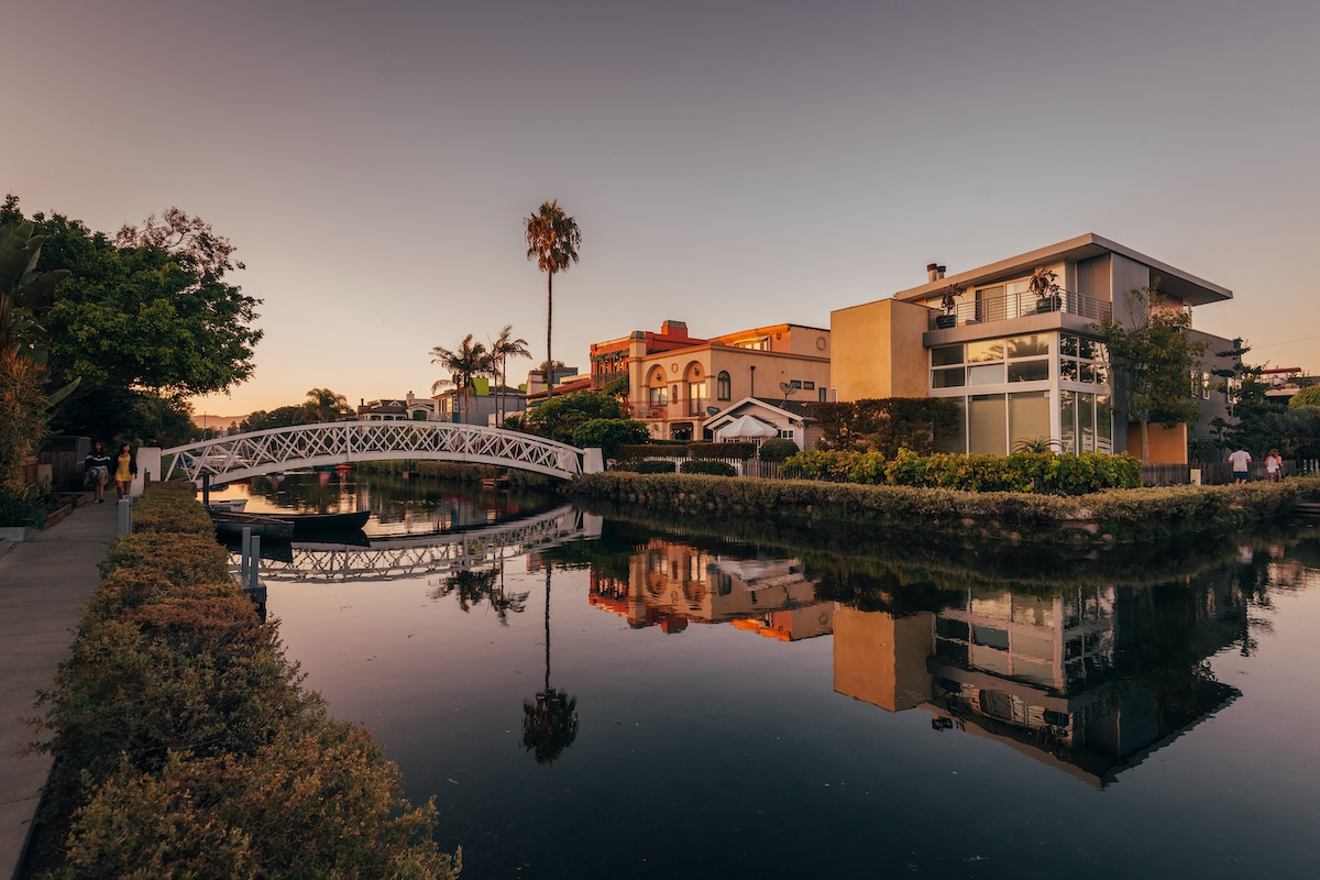 Canal and houses at sunset, in Venice Beach, Los Angeles, California