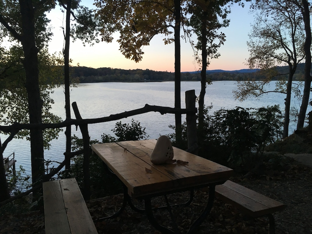 Secluded Cabins in Arkansas with paddle boat and fire pit