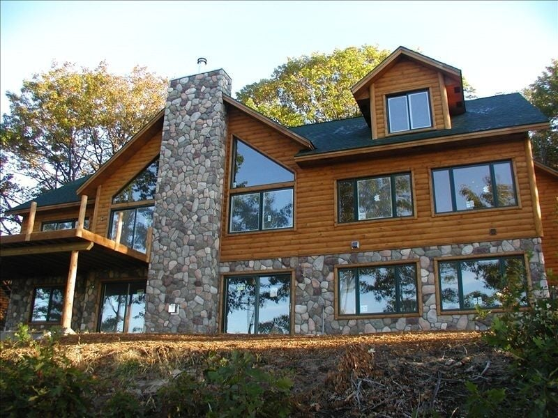 Secluded Cabins in Michigan large sleeps 20 with hot tub game room and golf