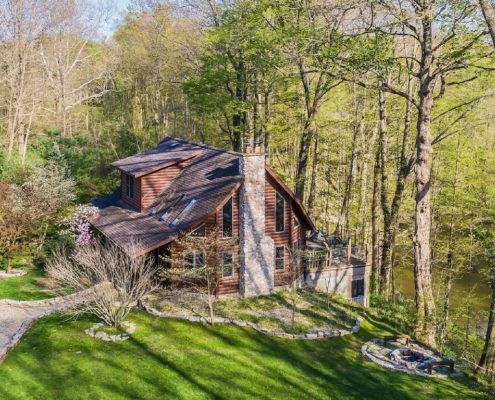 Secluded Cabins in Michigan riverfront close to town with hot tub and fire pit
