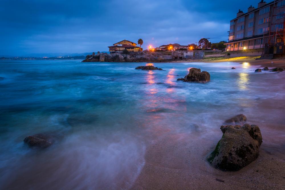 Rocky beach at twilight, in Monterey, California.